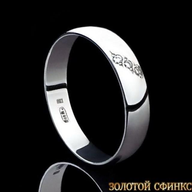 Обручальное кольцо из платины с бриллиантами 091100