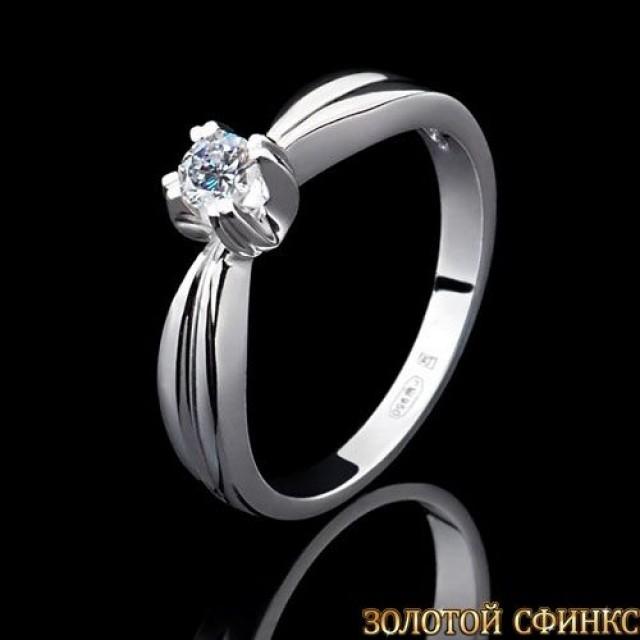 Обручальное кольцо из платины с бриллиантом 091106