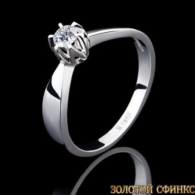 Обручальное кольцо из платины с бриллиантом 091108